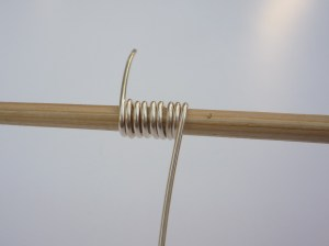 Coiling wire on a mandrel