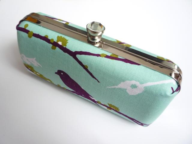 Fabric covered shell handbag