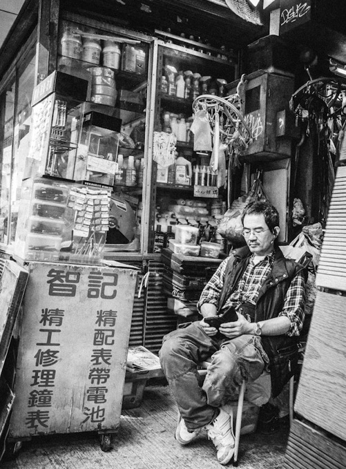 Shopkeeper in Wan Chai in B&w