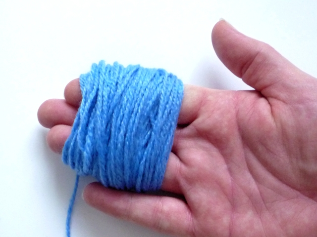 Q1 winding wool around fingers