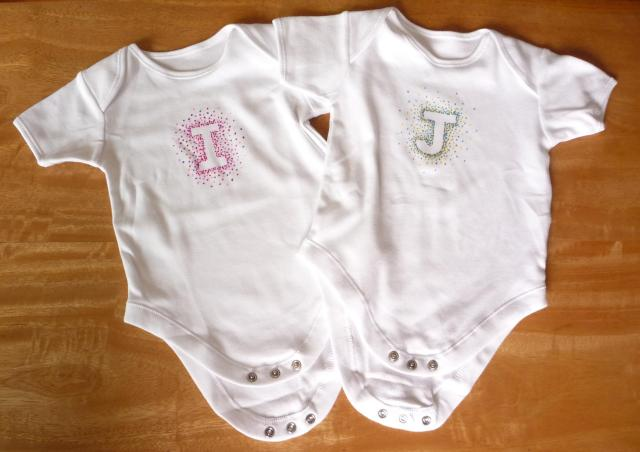 Hand decorated initial letter babygros