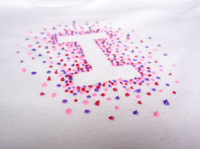 Initial letter dotted babygro design