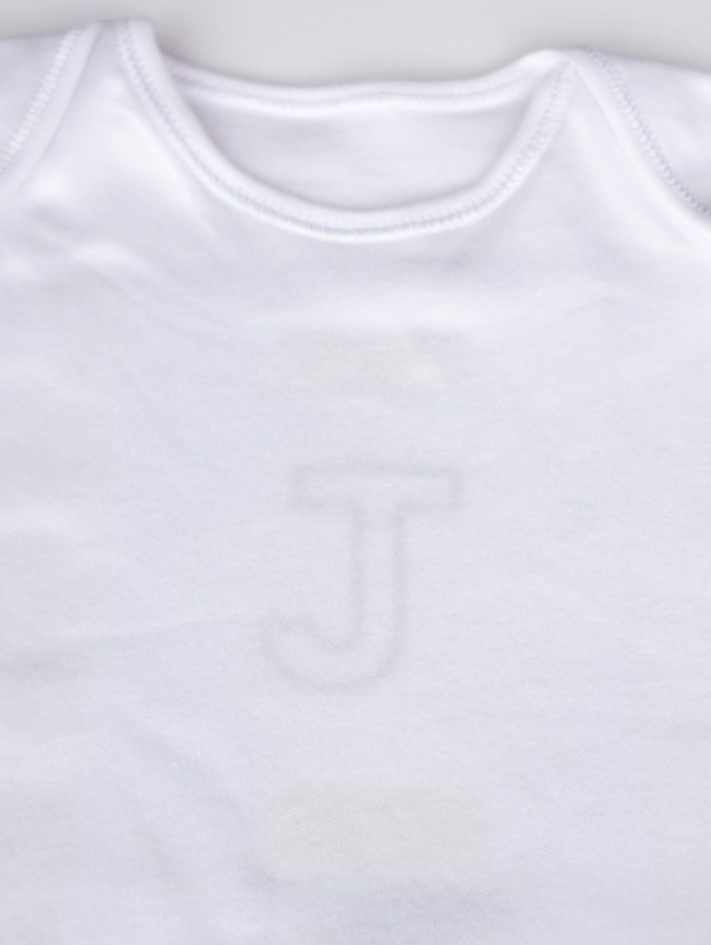 Place initial inside babygro