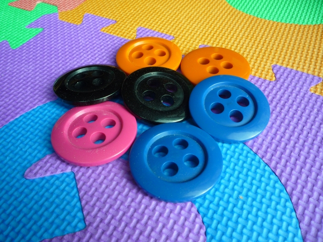 Big buttons as toys