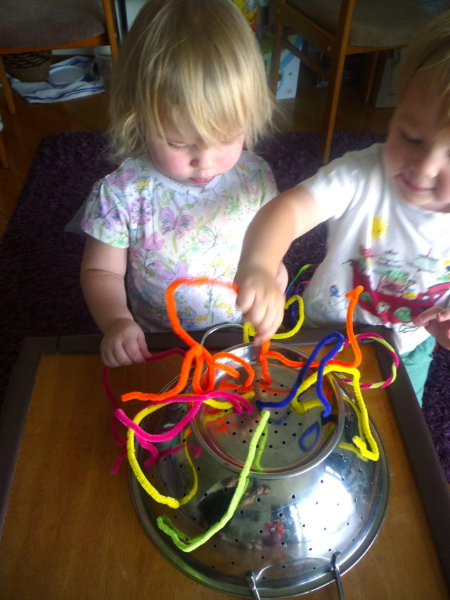 toddler activities - pipe cleaners in colander